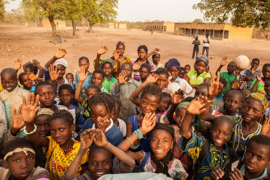 African children waving and smiling