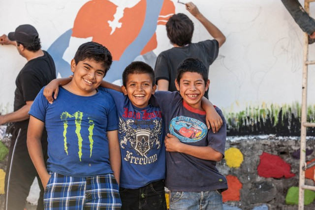 three boys posing for the camera in Central America