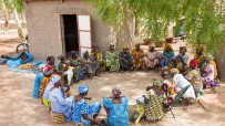 malian women sitting in circle
