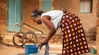 Woman doing laundry in burkina faso