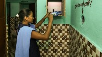 young indian woman taking a sanitary pad