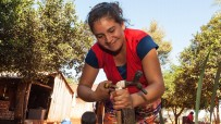 Woman adjusting a water faucet in Paraguay