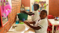 girls washing their hands