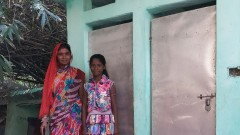 Khushbu and her mother in front of the IHHL constructed in their house.